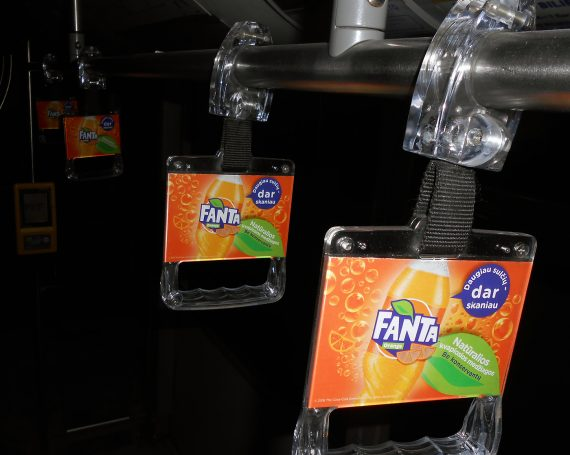 Fanta ad in public transport handles