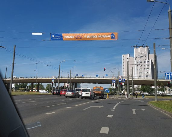 Švaros broliai advertising on tilts above the streets