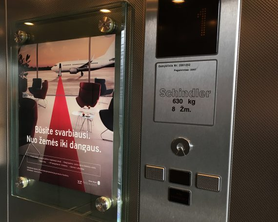 Vilniaus airport advertising in business center lifts