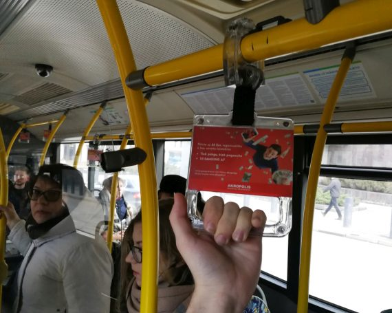Akropolio advertising in public transport handles